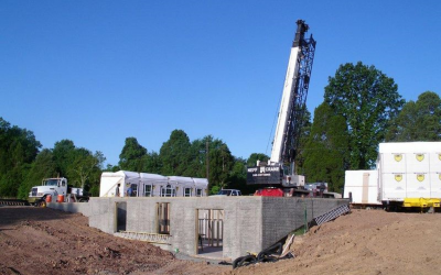 This image shows that full basements are built in advance of custom modular homes arriving.